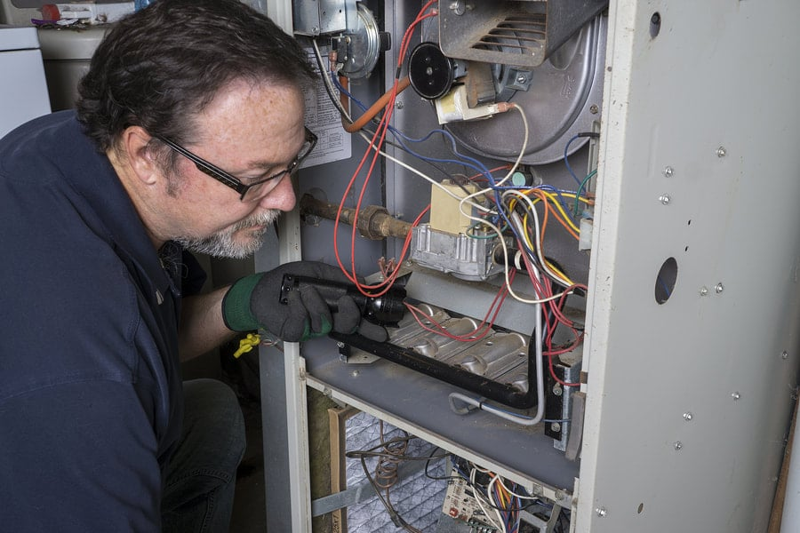 A Man Inspecting a Furnace