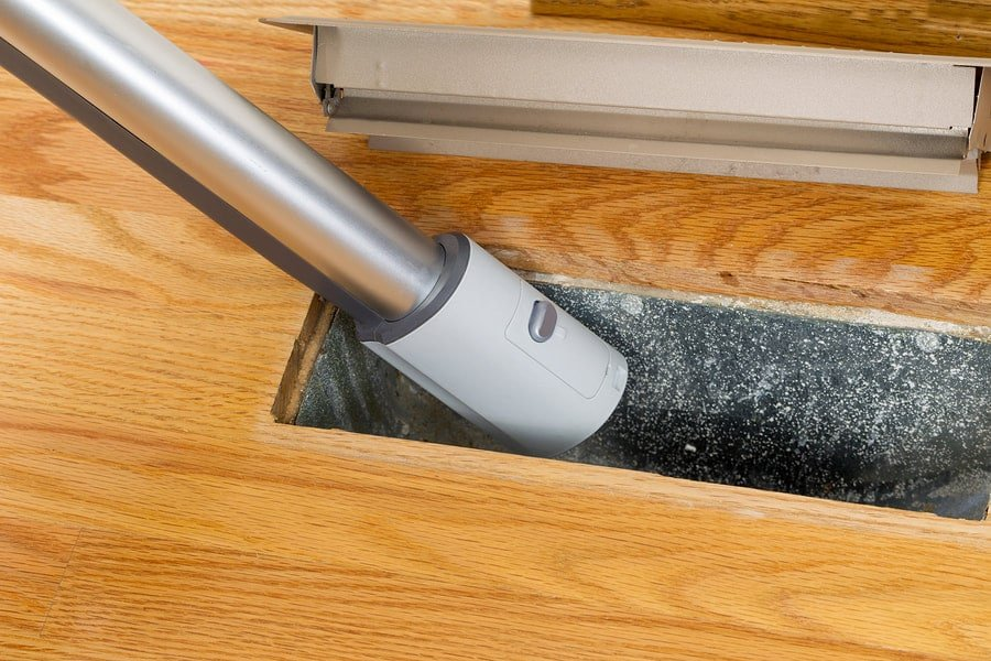 A Vacuum Cleaning an Air Duct